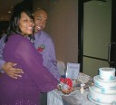 Lori & Leroy cutting the cake.