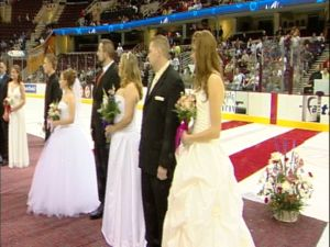 Couples get married during local hockey game in Cleveland, OH.
