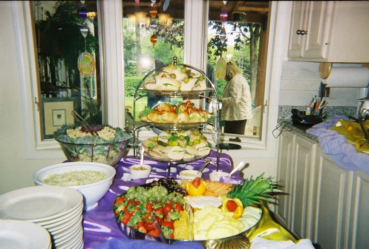 There were 3 kinds of sandwiches and fruit and vegetable trays.