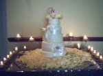 The candlelit cake table.